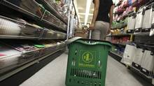 A shopper at the Dollarama store on Spadina Avenue in Toronto on June 13, 2012. (Deborah Baic/The Globe and Mail)