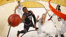 Duane Notice #10 of the South Carolina Gamecocks shoots the ball against Luke Kennard #5 of the Duke Blue Devils in the second half during the second round of the 2017 NCAA Men's Basketball Tournament in Greenville, South Carolina. (Gregory Shamus/Getty Images)