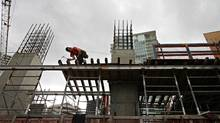 Workers construct a condo development in downtown Vancouver in this file photo. (Simon Hayter/SIMON HAYTER for The Globe and Mail)