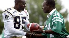 Winnipeg Blue Bombers Milt Stegall receives congratulations from former Roughrider George Reed before the Labour Day game in CFL action on Sunday, Sept 2, 2007 in Regina. Reed is to be honoured with the Saskatchewan Order of Merit Nov. 4, 2013. (TROY FLEECE/CP)