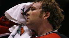 New Jersey Devils goalie Martin Brodeur towels off after the overtime period of their NHL hockey game with the Toronto Maple Leafs in East Rutherford, New Jersey, March 2, 2007.  (Reuters)