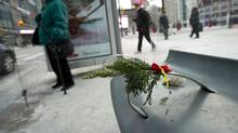 A make-shift memorial is seen at a TTC stop on Dundas near Yonge where a man was found without vital signs in Toronto, Ontario, Tuesday, January 6, 2015.