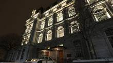 A Surete du Quebec police car sits outside the doors of Montreal City Hall during a raid by the province's anti-corruption squad in Montreal, February 19, 2013. (CHRISTINNE MUSCHI/Reuters)
