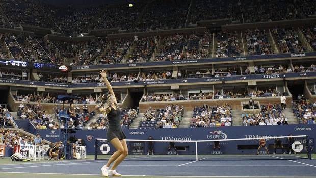 Maria Sharapova of Russia serves to Lourdes Dominguez Lino of Spain during their match at the US Open women's singles tennis tournament in New York, August 29, 2012. (ADAM HUNGER/REUTERS)