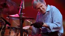 In this Aug. 14, 2009, file photo, Levon Helm performs with the Levon Helm band during the Heroes of Woodstock concert at Bethel Woods Center for the Arts in Bethel, N.Y. Elton John and Mumford & Sons will hit the Grammys stage to pay tribute to Helm. (Craig Ruttle/AP)