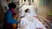 Five-year-old Katherine Vitorino, who has cerebral palsy, takes part in a session with music therapist Carolyn Williams at the Hospital for Sick Children (Galit Rodan/THE CANADIAN PRESS)