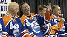 Mark Messier, Wayne Gretzky and Jari Kurri have a laugh as Paul Coffey tells stories during the 1984 Stanley Cup Reunion Introductory Media Availability in Edmonton, Alta., on Wednesday October 8, 2014. (JASON FRANSON/THE CANADIAN PRESS)