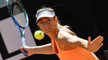 Maria Sharapova returns the ball to Christina McHale at the ATP Tennis Open tournament at the Foro Italico in Rome, May 15, 2017. (ANDREAS SOLARO/AFP/Getty Images)
