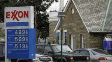 Gasoline prices hover near the $5 a gallon mark at an Exxon station in Washington on March 2. (GARY CAMERON/GARY CAMERON/REUTERS)
