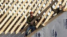 In this Thursday, Dec. 6, 2012, photo a new home is constructed in Pepper Pike, Ohio. (Tony Dejak/AP)
