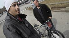 Stavros Theodorakopoulos bought a bike to replace the one he stole from his childhood friend Joshua Stern. The two are now are running an anti-bullying program over March Break for kids who have been in trouble with police. (J.P. Moczulski/The Globe and Mail/J.P. Moczulski/The Globe and Mail)