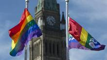 The Pride flags fly on Parliament Hill following a ceremony with Prime Minister Justin Trudeau in Ottawa, on June 14, 2017. (Adrian Wyld/THE CANADIAN PRESS)