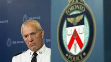 Toronto Police Chief Bill Blair listens as former Supreme Court of Canada justice Frank Iacobucci (not pictured) delivers his report on the use of lethal force by Toronto Police during a press conference in Toronto on Thursday, July 24, 2014. Toronto's police services board has decided against renewing the contract of Blair, who has frequently clashed with Mayor Rob Ford. THE CANADIAN PRESS/Darren Calabrese (Darren Calabrese/THE CANADIAN PRESS)