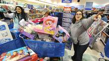 """File photo of shoppers at a Toys """"R"""" Us in Millcreek Township, near Erie, Pa. (Christopher Millette/AP)"""