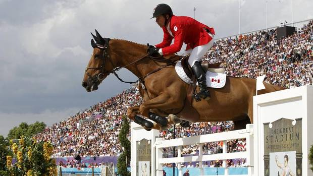 Canada's Eric Lamaze rides Derly Chin De Muze during the equestrian individual jumping third qualifier in Greenwich Park at the London 2012 Olympic Games Mon., Aug. 6, 2012. (Mike Hutchings/Reuters)