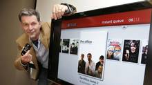 Netflix CEO Reed Hastings shows off their new set top box at Netflix headquarters in Los Gatos, Calif., Friday, May 16, 2008. (Paul Sakuma/AP)