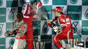 Ferrari Formula One driver Alonso, teammate Massa and McLaren driver Lewis Hamilton spray champagne as they celebrate on the podium after Alonso won the South Korean F1 Grand Prix at the Korea International Circuit in Yeongam.