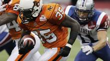 BC Lions' Martell Mallett (L) eludes a tackle by Montreal Alouettes' Chip Cox during CFL football action in Vancouver, British Columbia, September 4, 2009. REUTERS/Lyle Stafford (CANADA SPORT FOOTBALL)