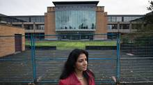 Anita Huberman, chief executive officer of the Surrey Board of Trade, stands outside a commercial building that takes up an entire city block and has sat empty since it was completed about 16 years ago, at 14178 104 Ave. in Surrey, B.C., on Thursday November 17, 2016. Darryl Dyck/The Globe and Mail (DARRYL DYCK/THE GLOBE AND MAIL)