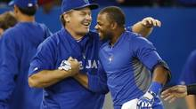 Toronto Blue Jays Rajai Davis celebrates his game winning single with manager John Gibbons (L) to defeat the Baltimore Orioles during the ninth inning of their American League baseball game in Toronto, June 21, 2013. (MARK BLINCH/REUTERS)