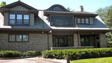Billionaire Warren Buffett still lives in the Omaha, Nebraska house he bought in 1958 for $31,500. (Photo from Wikipedia.)