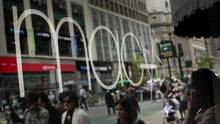 Pedestrians walk past a Macy's Inc. store in New York. (Victor J. Blue/Bloomberg)