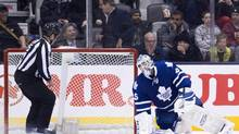 Toronto Maple Leafs goalie Jonathan Bernier reacts after mishandling the puck and allowing a New York Islanders goal during second period NHL action in Toronto on Tuesday, January 7, 2014. (Nathan Denette/THE CANADIAN PRESS)