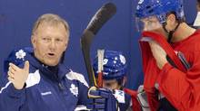 Toronto Maple Leafs Head Coach Ron Wilson (left) offers advice to new signing David Steckel during the final practice session Toronto on Wednesday October 5, 2011, ahead of tomorrow's season opener against Montreal Canadiens. Photo by Chris Young for The Globe and Mail (Chris Young/The Globe and Mail)