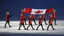 Mounties carry in the Canadian flag into B.C. Place during the opening ceremonies of the Vancouver Winter Olympics on Feb. 12, 2010. (Fred Lum/The Globe and Mail)