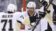 Pittsburgh Penguins' Jarome Iginla, centre, is congratulated by teammates Evgeni Malkin and James Neal after scoring against the Ottawa Senators during second period NHL playoff action in Ottawa, Wednesday May 22, 2013. (Adrian Wyld/THE CANADIAN PRESS)