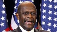 Republican presidential candidate Herman Cain is reassessing his presidential campaign in light of new allegations of infidelity. (MATT/AP/MATT YORK/AP)