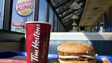A cup of Tim Hortons coffee is pictured Burger King Whopper at a Burger King restaurant in Toronto on Monday August 25, 2014. (Chris Young/Chris Young for The Globe and Mail)
