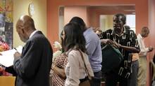 People wait in line to meet with job counsellors during a job fair at Workforce1 in New York Sept. 6, 2012. (BRENDAN MCDERMID/REUTERS)