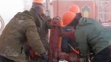 Rosneft employess work at the Vankor oil field in eastern Siberia in temperatures of around -40C in a file photo. (Sergei Karpukhin/Reuters)