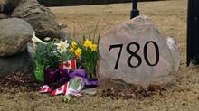 Floral tributes and Canadian flags outside Jim Flaherty's house in Whitby, Ont., April 10, 2014. (Karen McColl/Globe and Mail)