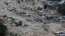 Boulders and debris surround homes on Tuesday, April 4, 2017, after rivers surrounding Mocoa, Colombia overflowed and sent a wall of water and debris surging through the city over the weekend. (Fernando Vergara/AP)