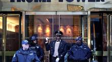 A doorman, center, talks with security personnel at the front entrance of Trump Tower in New York, Thursday, Nov. 17, 2016. Google Maps has apologized for a brief period on Saturday in which Vancouver's Trump Tower was labelled 'Dump International Hotel and Tower.' (Seth Wenig/AP Photo)