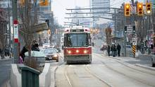 Passengers board a streetcar on St. Clair Ave. between Bathurst and Dufferin in Toronto, Ont. Feb. 9, 2012. (Kevin Van Paassen/The Globe and Mail/Kevin Van Paassen/The Globe and Mail)