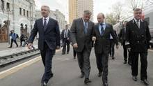 Vladimir Yakunin, pictured here beside Russia President Vladimir Putin, is considered a close confidant of Mr. Putin. (ALEXEY DRUZHININ/AFP/Getty Images)