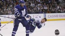 Maple Leafs forward Nazem Kadri hits Canucks forward Daniel Sedin during a game at the Air Canada Centre on Saturday. (John E. Sokolowski/USA Today Sports)