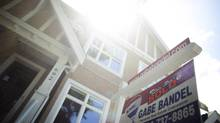 A real estate board report notes a 14-per-cent increase in sales in 2013. (Rafal Gerszak For The Globe and Mail)