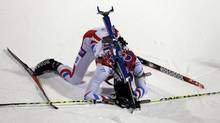 France's Martin Fourcade lies on the snow after completing the men's biathlon 10-km sprint, at the 2014 Winter Olympics, Saturday, Feb. 8, 2014, in Krasnaya Polyana, Russia. (Kirsty Wigglesworth/AP)