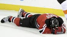 New Jersey Devils' forward Dainius Zubrus lies on the ice after being hit by Philadelphia Flyers' Claude Giroux during the second period in Game 4 of their NHL Eastern Conference semi-final playoff hockey game in Newark, N.J. (RAY STUBBLEBINE/Reuters)