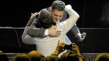 Michael Bublé hugs a member of the audience while performing at the Air Canada Centre in Toronto on Aug. 10 (J.P. Moczulski/The Globe and Mail)