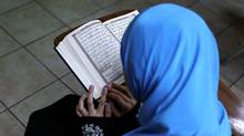 A young Muslim girl recites a verse from the Quran during Arabic language lessons at Masjid Al-Salaam, a mosque and Islamic community center in Dearborn, Michigan, U.S., on November 13, 2016. (BRITTANY GREESON/REUTERS)