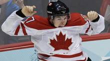 Canada's Sidney Crosby (87) leaps in the air after scoring the game-winning goal in the overtime period of a men's gold medal ice hockey game against USA at the Vancouver 2010 Olympics in Vancouver, British Columbia, Sunday, Feb. 28, 2010. Crosby's missing stick and glove have been found. Hockey Canada says the missing Olympic gear was misplaced rather than stolen, with both items ending up in the wrong place in the process of packing and shipping equipment after the Olympic final.THE CANADIAN PRESS/AP-Chris O'Meara (Chris O'Meara/CP)
