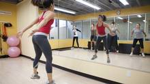 Instructor Mimi Au, centre, leads, from left, Alexa Mensen, Vanessa Gravina, Keren Kurtz and Annika Greve in the hangover cure workout at Urban Playground Fitness Inc. in Toronto on Sunday, Sept. 9, 2012. (Matthew Sherwood for The Globe and Mail)