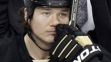 Pittsburgh Penguins' Arron Asham (45) sits on the bench during the final minute of an 8-5 loss to the Philadelphia Flyers during Game 2 of an opening-round NHL hockey Stanley Cup playoff series in Pittsburgh Friday, April 13, 2012. (Gene J. Puskar/Associated Press)