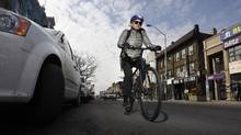 A cyclist rides eastbound on Bloor St. West on March 8 2016. (Fred Lum/The Globe and Mail)