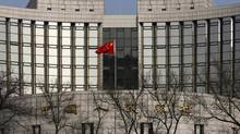 A Chinese national flag is seen at the headquarters of the central bank of China in Beijing February 20, 2013. (Kim Kyung-Hoon/Reuters)